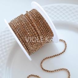 Стразовая цепь светлая бронза, оправа светлая бронза 2 мм.