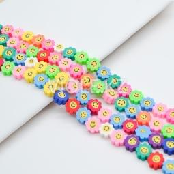 Цветные бусины цветочки со смайликом, каучук, 9,5 мм., нить